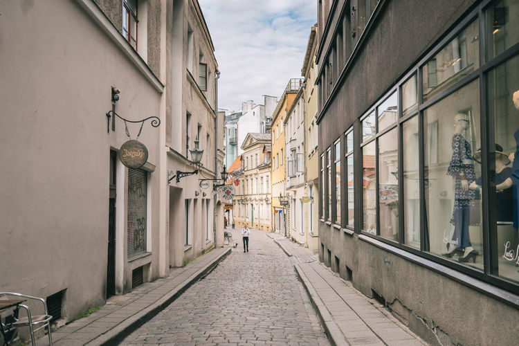 Tallinn Architecture Building Exterior Built Structure Building City Direction The Way Forward Street Footpath Day Residential District Incidental People Lighting Equipment Nature Outdoors Real People Diminishing Perspective Sky Window Sidewalk Alley