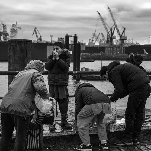 Blackandwhite City Cold Crane Fischmarkt Kids Market Monochrome Outdoors River Ship Sky Streetphotography Vessel The Street Photographer The Street Photographer - 2017 EyeEm Awards The Photojournalist - 2017 EyeEm Awards