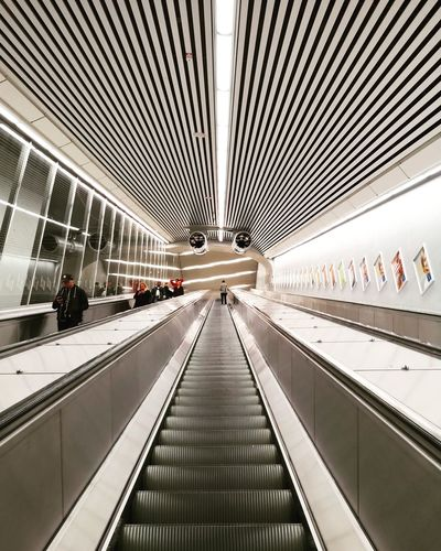 Airport Airport Terminal Architecture Built Structure Ceiling Convenience Diminishing Perspective Direction Escalator Futuristic Group Of People Illuminated Incidental People Indoors  Modern Moving Walkway  Railing Real People Technology The Way Forward Transportation Travel