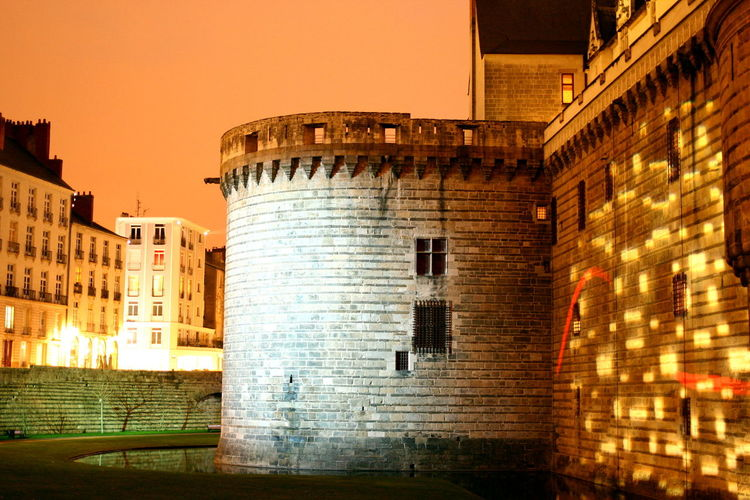 Walk by the castle Architecture Built Structure Building Exterior Outdoors Lights Light And Shadow Light In The Darkness Light Over Water Light On Castle Lines And Patterns Castle Castle Tower Water Nantes France Night Shot Nightphotography Night Night Photography Canon EOS