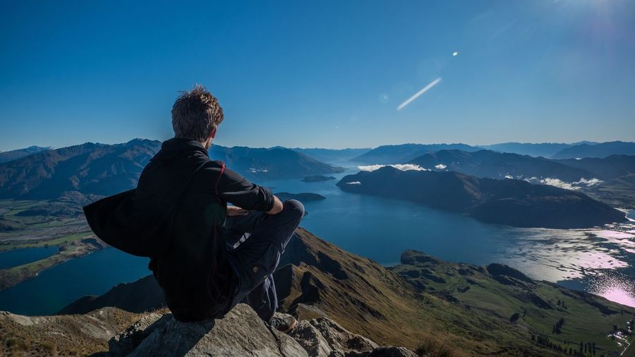 Mountain One Person Real People Full Length Mountain Range Leisure Activity Sitting Hiking Lifestyles Scenics Beauty In Nature Outdoors Nature Men Day Adventure Young Adult Lake Sky Landscape New Zealand