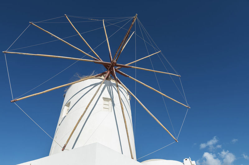 Iconic Windmill Santorini Windmill Alternative Energy Blue Built Structure Clear Sky Day Environment Environmental Conservation Fuel And Power Generation Iconic Low Angle View Nature No People Outdoors Renewable Energy Sky Sunlight Traditional Windmill Turbine White Color Wind Power Wind Turbine