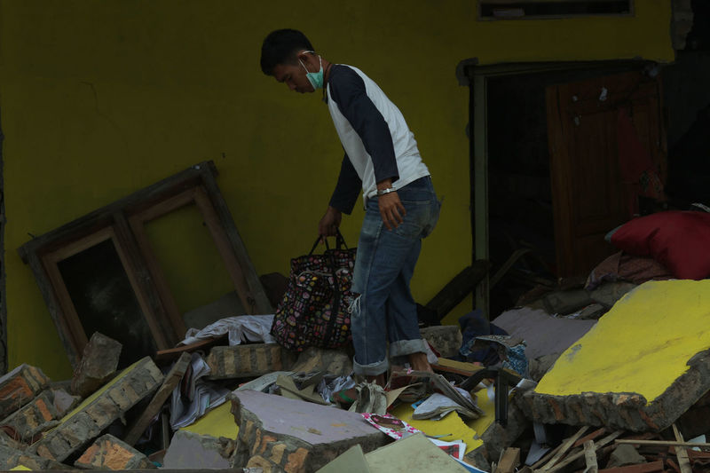 Tsunami Aftermath in Lampung, Indonesia One Person Standing Real People Casual Clothing Young Adult Full Length Men Lifestyles Young Men Furniture Side View Messy Domestic Room Home Interior House Indoors  Day Three Quarter Length Leisure Activity Tsunami Tsunami Disaster Lampung South Lampung
