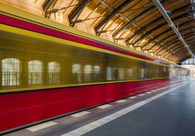Blurred motion of train moving at railroad station