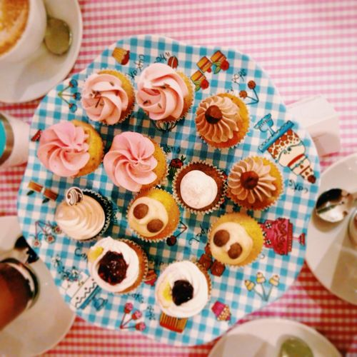 High angle view of cup cakes in plate