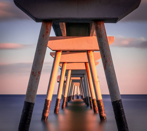 Water Sea Sky Sunset Horizon Over Water Architecture Horizon Nature Built Structure No People Scenics - Nature Orange Color Tranquility Wood - Material Beauty In Nature Pier Architectural Column Tranquil Scene Outdoors Underneath Pont Del Petroli Pont Del Petroli, Badalona, Spain Long Exposure Clouds Calm Place
