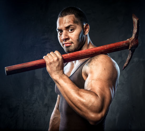Muscular man holding pickaxe Force Man Messy Power Athlete Axe Dirty Equipment Hammer Hand Tool Miner Mining Muscle Muscular Muscular Build Muscular Man One Man Only One Person Pick Pickaxe Powerful Professional Occupation Sportsman Strength Strong