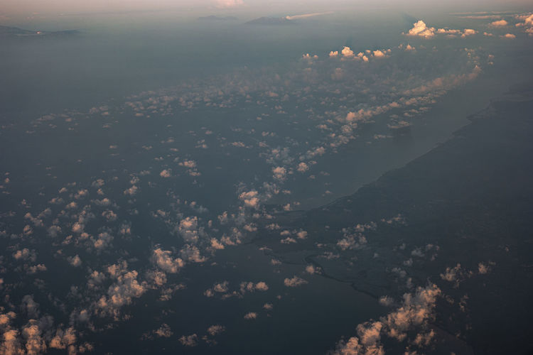 High angle view of clouds over sea during sunset
