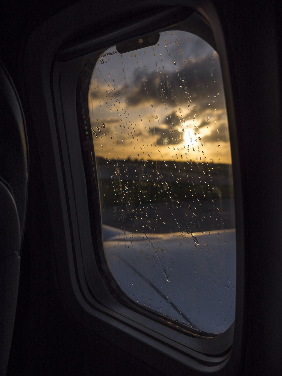 window, glass - material, vehicle interior, water, car interior, drop, cloud - sky, wet, weather, sky, no people, car, indoors, transportation, close-up, land vehicle, nature, day