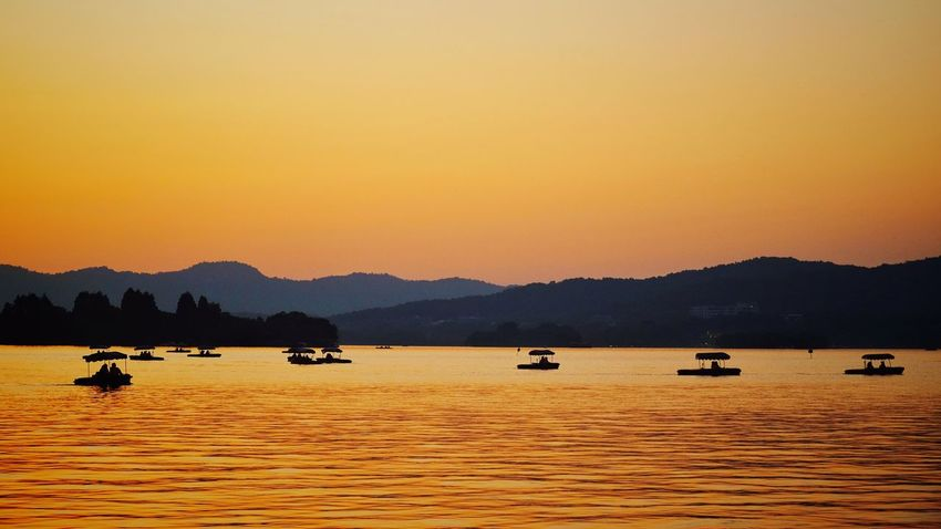 Sunset Silhouette Mountain Lake Outdoors No People Landscape Scenics Water Nature Sky Beauty In Nature Tranquility Travel Destinations Lake View China View West Lake, Hangzhou Light And Shadow Hangzhou,China Travel Vacations Summer Silhouette Yellow Warm Glow