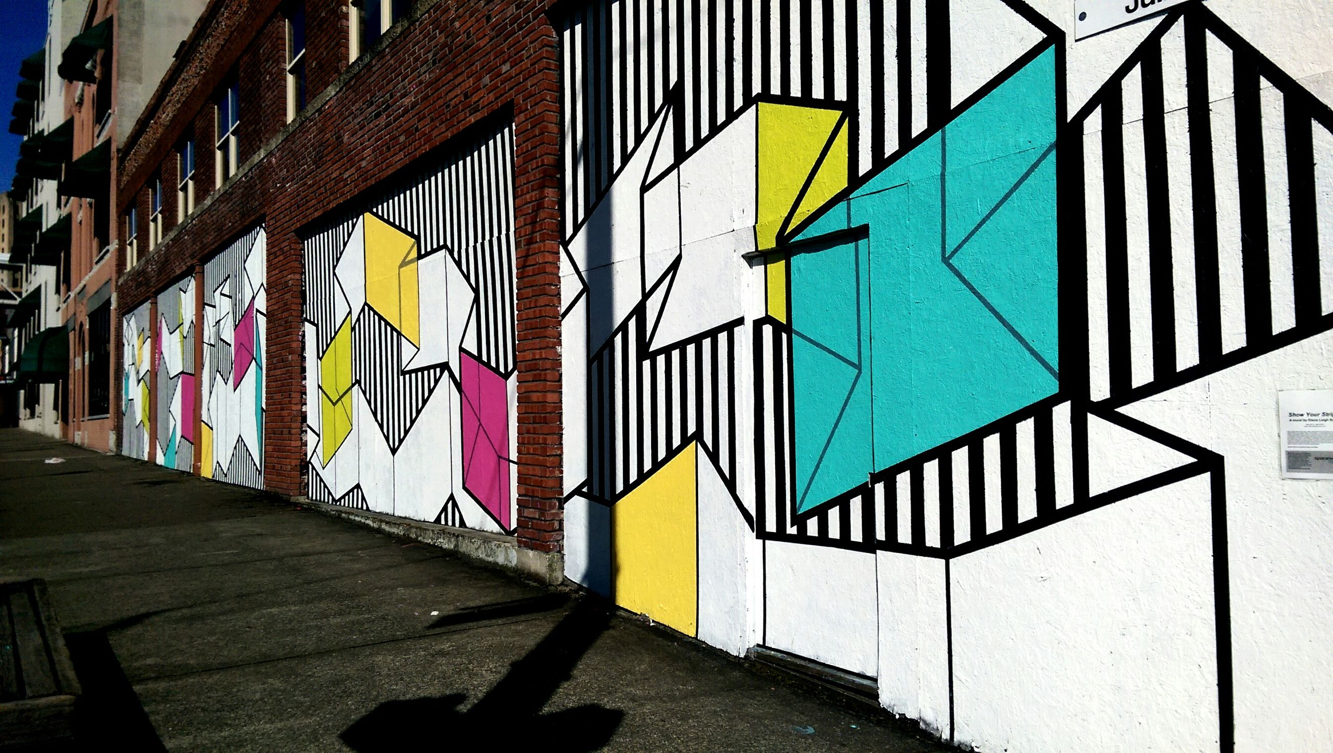 architecture, built structure, building exterior, multi colored, graffiti, building, window, residential structure, sunlight, shadow, wall - building feature, residential building, city, day, house, no people, wall, blue, street, outdoors