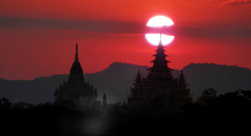 Silhouette of temple at sunset