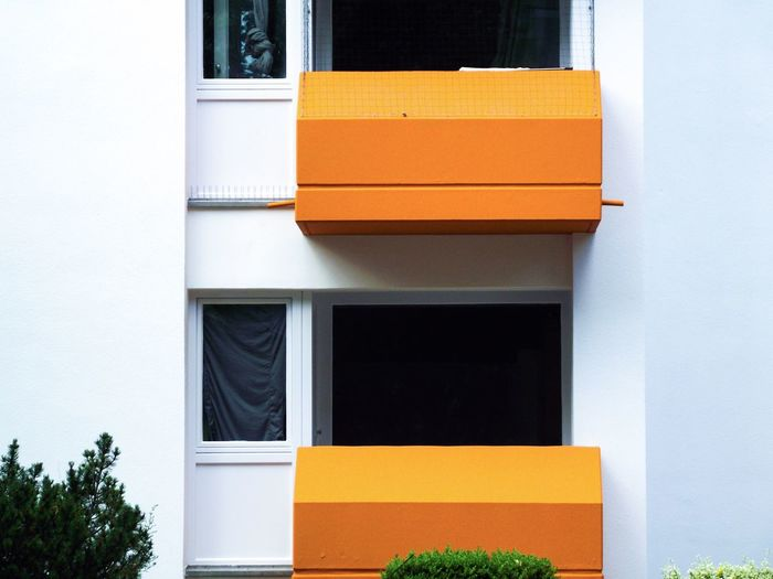 Balconies à l'Orange Excerpt White Orange Modern Architecture Urban Geometry Architecture Built Structure Building Exterior No People Window Building Day Wall - Building Feature Glass - Material Orange Color Outdoors Plant Residential District Design House Geometric Shape The Architect - 2018 EyeEm Awards