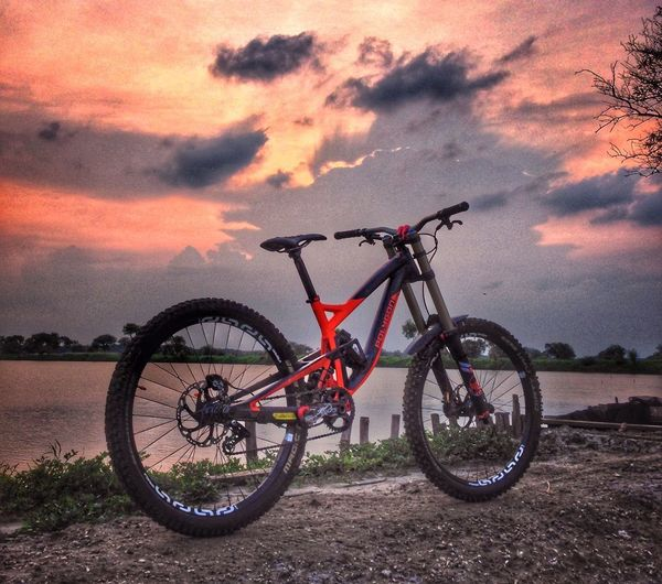 Bicycle Sunset Orange Color Cloud - Sky Child Pink Color Childhood Transportation Red Sky Stationary Children Only Outdoors Nature Beauty In Nature Day People Mountainbike Mountainbiking first eyeem photo Travel Polygonbikes Bikeporn Bikelove Bikesaroundtheworld Mountain