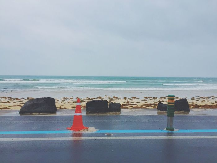 Traffic cones on road in beach