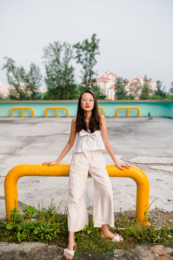 Portrait Of A Woman Portrait Photography portrait of a friend Retro Architecture And People Portrait Young Women Beautiful Woman Full Length Beauty Beautiful People Looking At Camera Legs Apart #urbanana: The Urban Playground