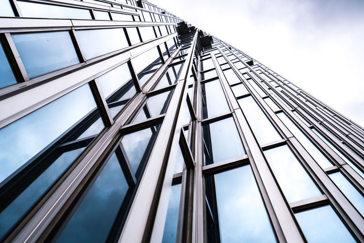 Architecture details Modern Building Glass facade Business background Center Construction Corporate District Downtown Finance Office Reflection Sky Structure Tall Urban Wall Window Abstract Architecture Background Blue Building Business City Cityscape Commercial Design Detail Development Futuristic Geometric Glass Growth High Highrise Metal Modern Perspective Skyscraper Steel Estate Bank Exterior
