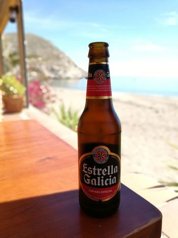 Bottle Focus On Foreground Drink Sunlight Day Food And Drink Alcohol Refreshment Cold Drink Outdoors No People Tree Freshness Nature Close-up Sky Estrellagalicia