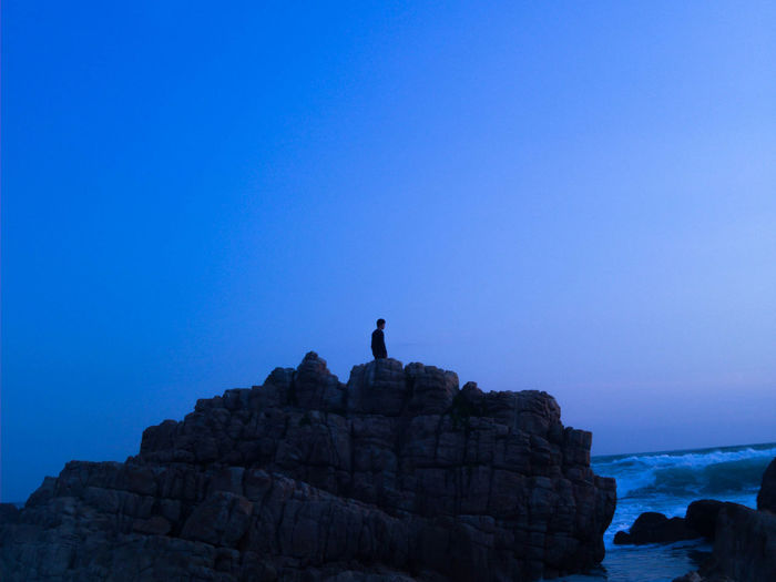 Rock - Object One Man Only Rock Formation Sky Landscape One Person Silhouette Blue Adult Only Men Adventure Travel Destinations Adults Only Hiking People Nature Travel Tranquility Rock Climbing Men EyeEmNewHere EyeEm Best Shots Eyeemsouthafrica South African Sunsets Eyemphotography