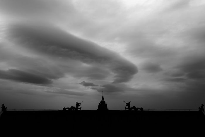 Cloudy sky over a Chinese temple; in black and white. Storm Architecture Black And White Building Exterior Built Structure China Cloud - Sky Clouds Danger Religion Sculpture Silhouette Sky Statue Storm Cloud