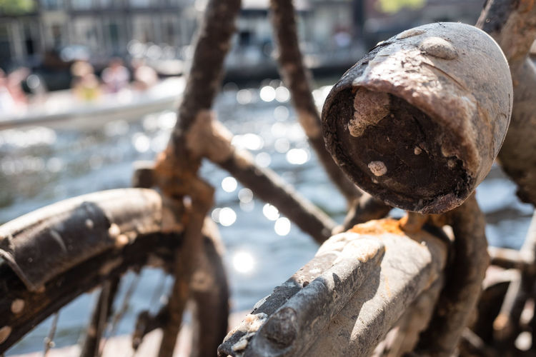 Bicycle lamp Focus On Foreground Close-up Day Transportation Metal Nature Outdoors Rusty No People Mode Of Transportation Selective Focus Sunlight Wood - Material Bicycle Water Old Architecture Damaged Textured  Wheel
