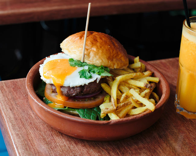 not healthy eating Burger Egg Yolk Burger Close-up Day Egg Food Food And Drink French Fries Freshness Hamburger Indoors  No People Ready-to-eat Serving Size Table Unhealthy Eating