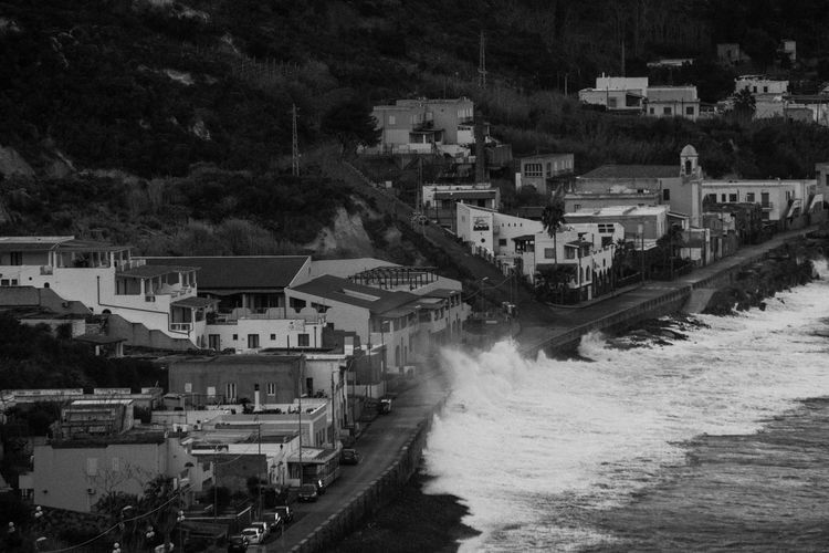 High angle view of buildings by sea at the island of lipari - sicily in a windstorm day in winter.