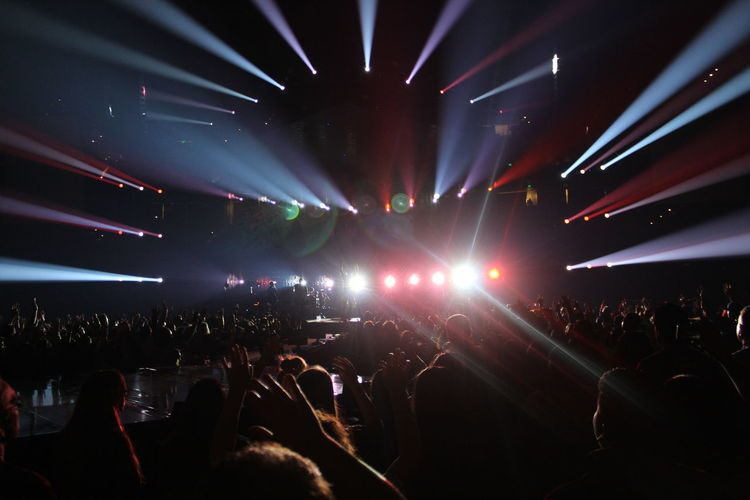 Arts Culture And Entertainment Concert Crowd Enjoyment Event Fun Illuminated Large Group Of People Leisure Activity Lifestyles Light Lighting Equipment Music Night Nightlife Performance Person Stage - Performance Space Youth Culture