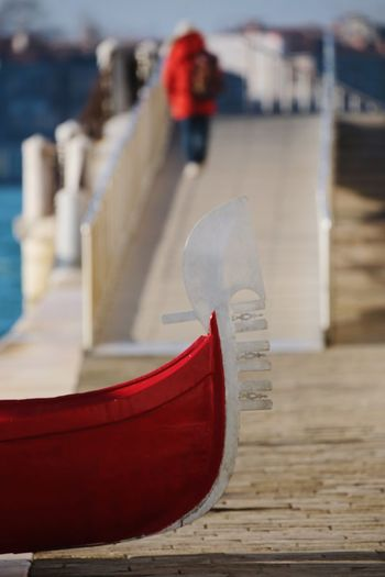 Close-up of red shoes on pier