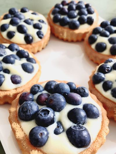 Close-up of served cookies with blueberries