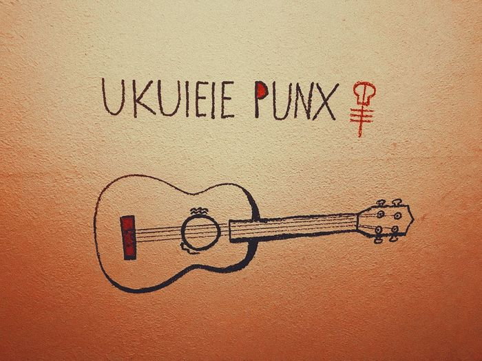 Ukulelepunk Punk Ukulele Text Communication Western Script Creativity Art And Craft No People Message Activity Graffiti Textured  Wall - Building Feature Sand Handwriting  Close-up Drawing - Activity Emotion Sign Positive Emotion Black Color