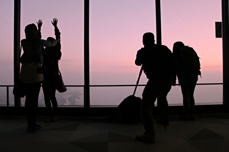 Friends in observation tower during sunrise