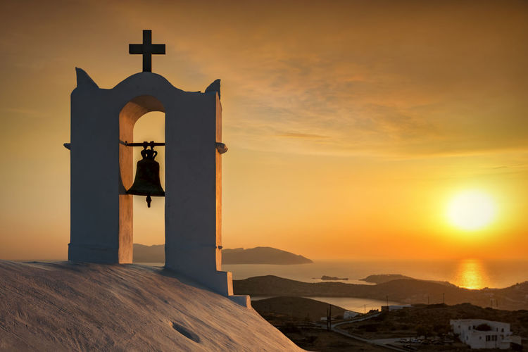 Romantic sunset over the Cyclades of Greece with view to the Aegean Sea Aegean Sea Greek Mediterranean  Orange Orthodox Church Romantic Architecture Belief Bell Bell Tower - Tower Building Building Exterior Cloud - Sky Cross Cyclades Europe Greece Ios Island Religion Religious Equipment Sky Spirituality Summer Sunset