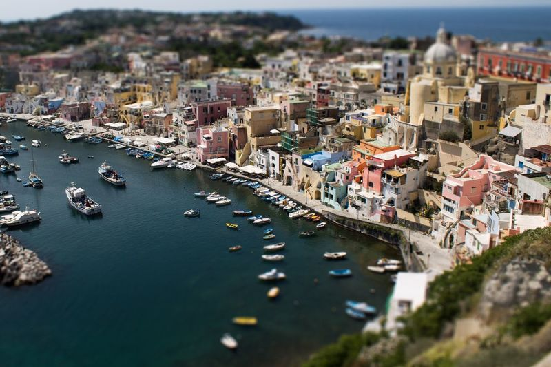 Tilt-shift image of sea by buildings