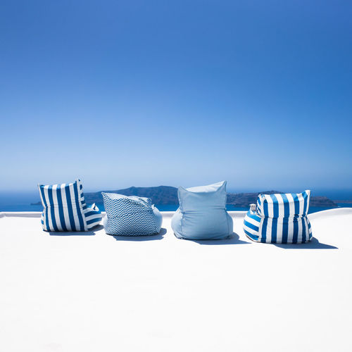 Absence Arrangement Beach Blue Chair Clear Sky Copy Space Day Folding Chair Greece Nature No People Outdoors Relaxation Sand Santorini Island Santorini, Greece Sea Seat Sky Striped Summer Tranquil Scene Tranquility Vacations