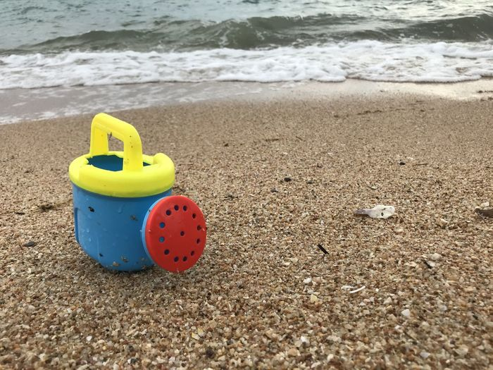 Toy on sand at beach