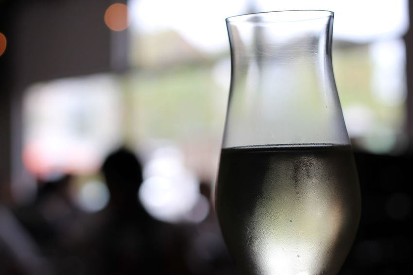 Focus On Foreground Drink Bottle Glass - Material Drinking Glass Refreshment Close-up Alcohol Liquid Indoors  Food And Drink Wineglass Wine Table Day No People Freshness