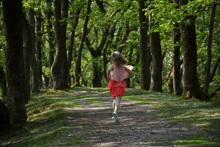 Running in the woods Forest Path Adventure Clothing Forest Forest Photography Full Length Hair In The Forest Into The Woods Nature on the move One Person Orange Dress Outdoors Path In Nature Plant Rear View Running Tree Tree Trunk Walking Women WoodLand Young Woman #FREIHEITBERLIN