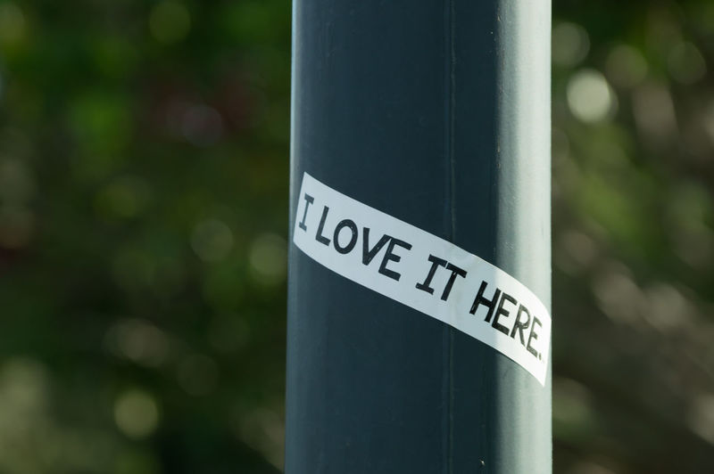 Close-up of text on pole