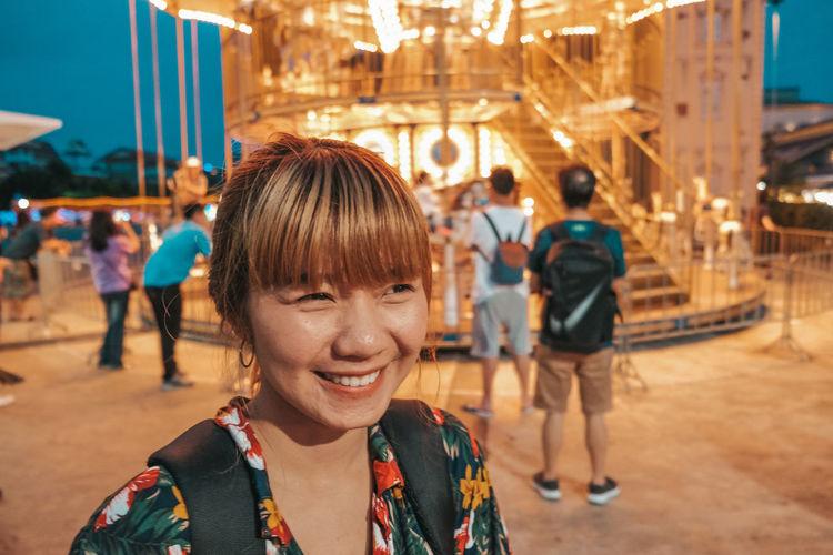 Portrait of people at amusement park