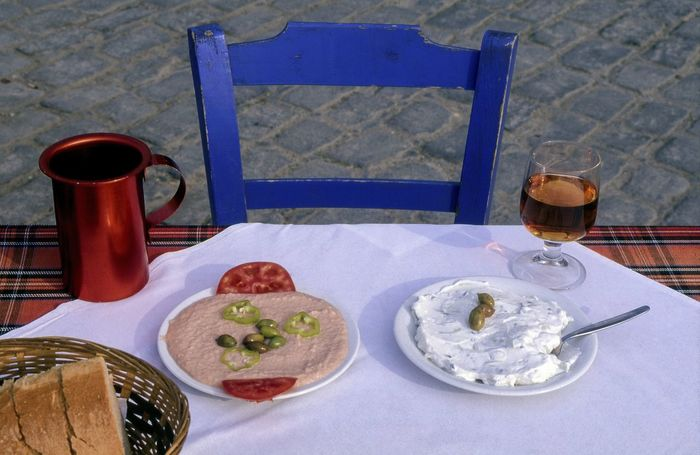 Greek Cuisine Starters. Bread, Taramasalata and Tzatziki with a Carafe of Red Wine Alfresco Bread Basket Chania Crete Crete Greece Food Food And Drink Food Photography Food Serving Foodporn Freshness Greek Cuisine Greek Food Healthy Eating Healthy Food Lunch Mediterranean Food No People Ready-to-eat Red Wine Table Taramasalata Tasty Traditional Food Tzatziki Wine Carafe