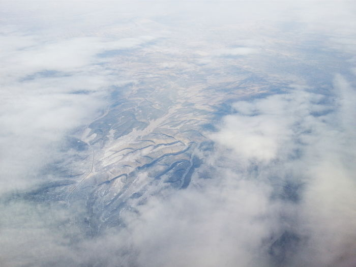 35,205 feet - a break in the clouds. #fromgreatheights #eyeinthesky #spotted #clouds #landscape nature