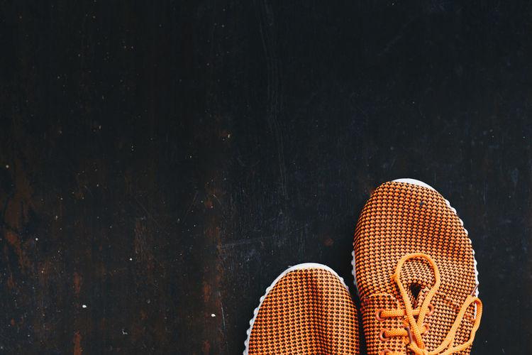 Directly above shot of orange shoes on floor