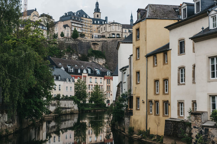 Houses on the bank of river alzette in luxembourg city, luxembourg.