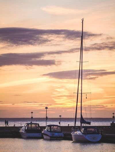 Inspired by Greece   Transportation Nautical Vessel Boat Mode Of Transport Sea Water Moored Sunset Cloud Calm Sky Tranquil Scene Tranquility Ocean Scenics Mast Nature Orange Color In A Row Outdoors EyeEm Nature Lover Eye4photography  EyeEm Gallery Sunset_collection Sunset Silhouettes