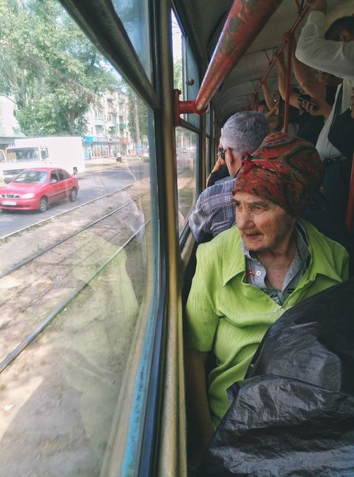 Travelling the tram ways of Odessa. Lifestyles People Contrast Soviet Era Dirty City Life Lonelyness Lonelyplanet Postsoviet Soviet Ghost City Cityofcontrasts Soviet Leftovers Abandoned Poor People  Misery Odessa,Ukraine Babushka Looking Through Window Tramway Elderly People