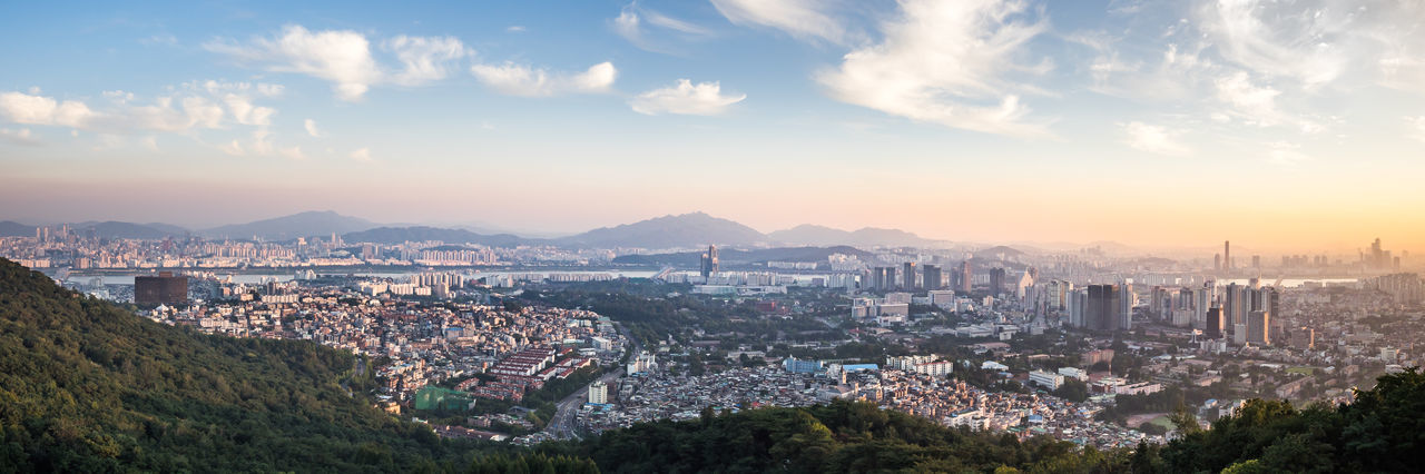 Large and high resolution Seoul City panorama, taken on a late sunny summer afternoon from the N Seoul Tower platform. High resolution and enhanced version of my former upload. Built Structure Capital Cities  City City Life Cityscape Cityscapes Cloud - Sky Mountain Mountain Range Nature No People Outdoors Panorama Panoramic View River Scenics Seoul Sky Sunset Town TOWNSCAPE Travel Destination Travel Destinations Urban Landscape Warm Colors
