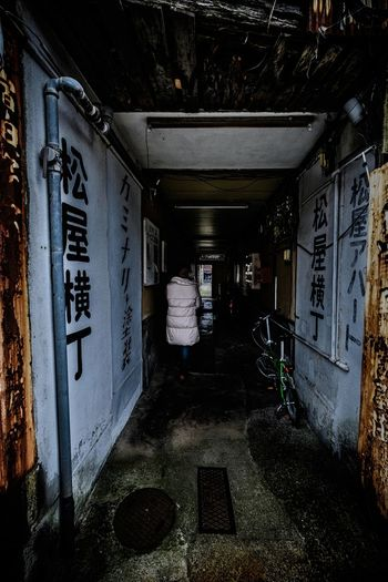 Matsuya Alley Capture The Moment Cityscape Japan The Week On EyeEm Urban Exploration Walker In Japan Architecture Building Exterior Built Structure Day Indoors  One Person People Street Photography Streetart Text White Wall