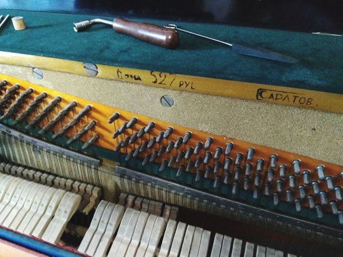 Tuning an old Soviet piano Ussr СССР пианино Soviet Soviet Piano Piano Tuning High Angle View Close-up Musical Equipment Piano Non-western Script Musical Instrument String String Instrument Piano Key