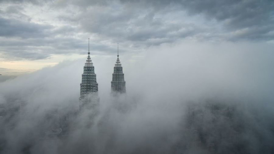Petronas Twin Towers above the clouds Aerial Shot Dronephotography Drone  Aerial View Aerial Photography Petronas Twin Towers Towers KLCC Twin Towers KLCC Tower Klcc Clouds Cloudporn Building Architecture Business Travel A Bird's Eye View
